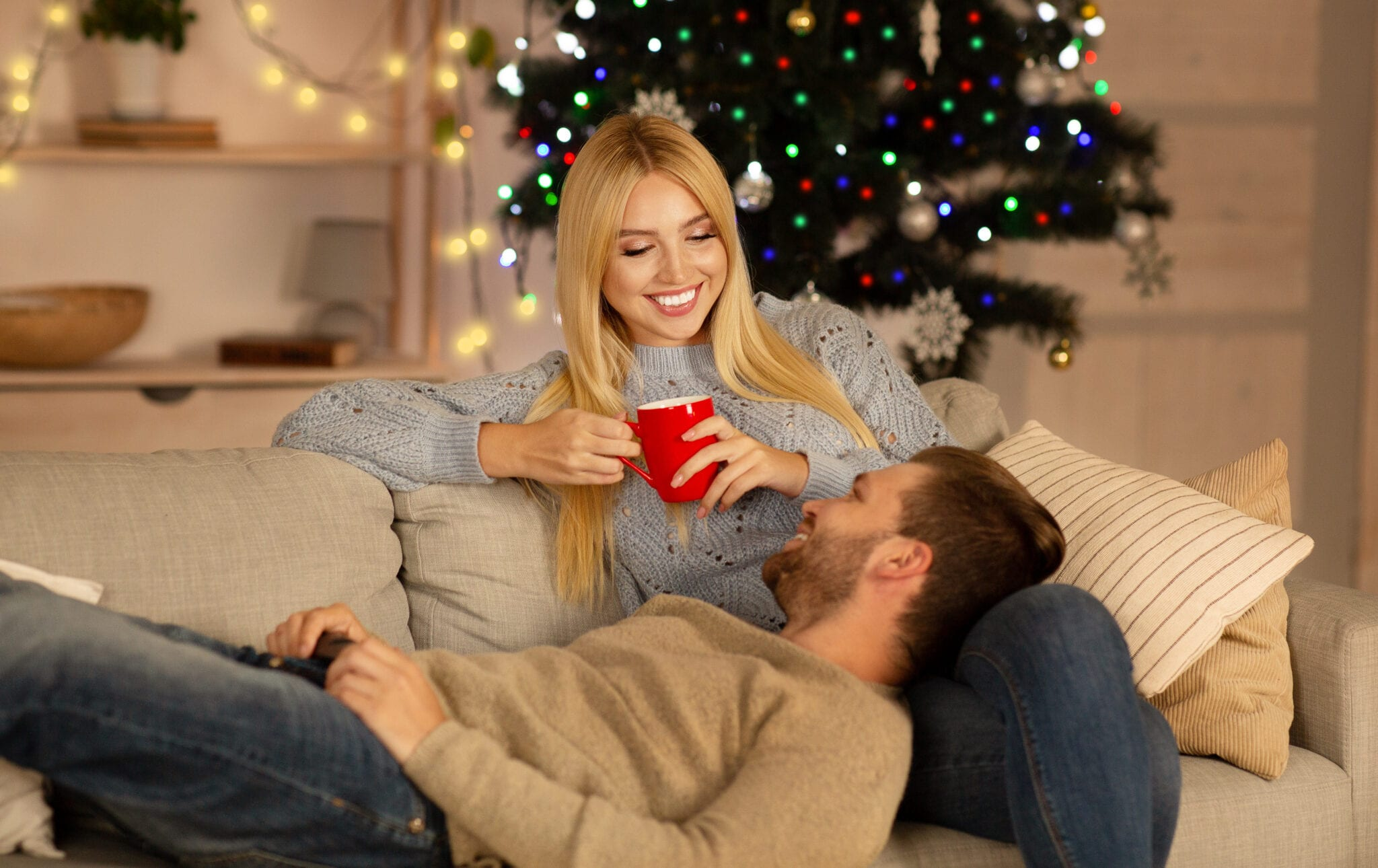 Lovely Couple Relaxing At Home during the holidays