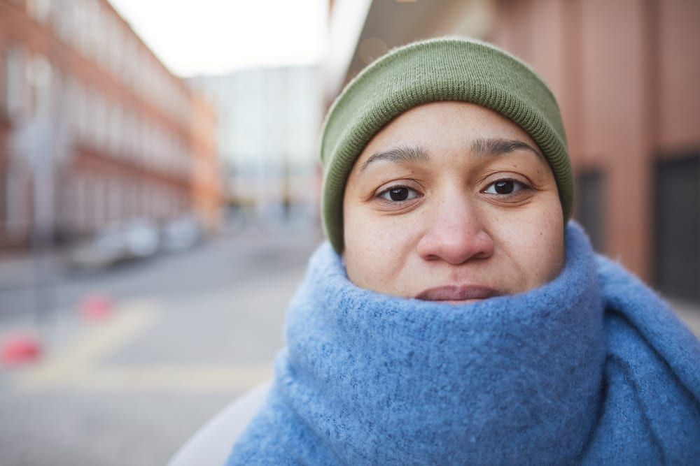 Woman In Cold Weather wearing scarf and hat